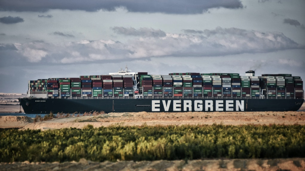 """29 March 2021, Egypt, Fayed: The """"Ever Given"""" container ship operated by the Evergreen Marine Corporation, sails through the Suez Canal, after it was fully freed and floated. Egypt's Suez Canal Authority announced that the stranded massive container ship that has blocked the Suez Canal for nearly a week, has been fully dislodged and successfully floating in the canal. Photo: Sayed Hassan/dpa (Photo by Sayed Hassan/picture alliance via Getty Images)"""