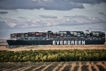 """29 March 2021, Egypt, Fayed: The """"Ever Given"""" container ship operated by the Evergreen Marine Corpor..."""