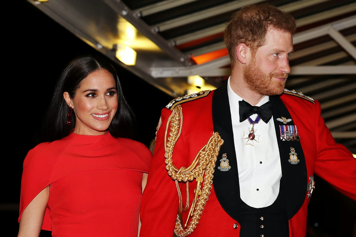 Meghan Markle and husband Harry wear matching red ensembles.