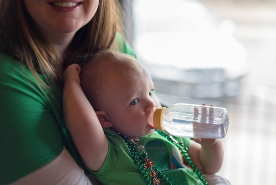 baby in st. patrick's day outfit on mom's lap