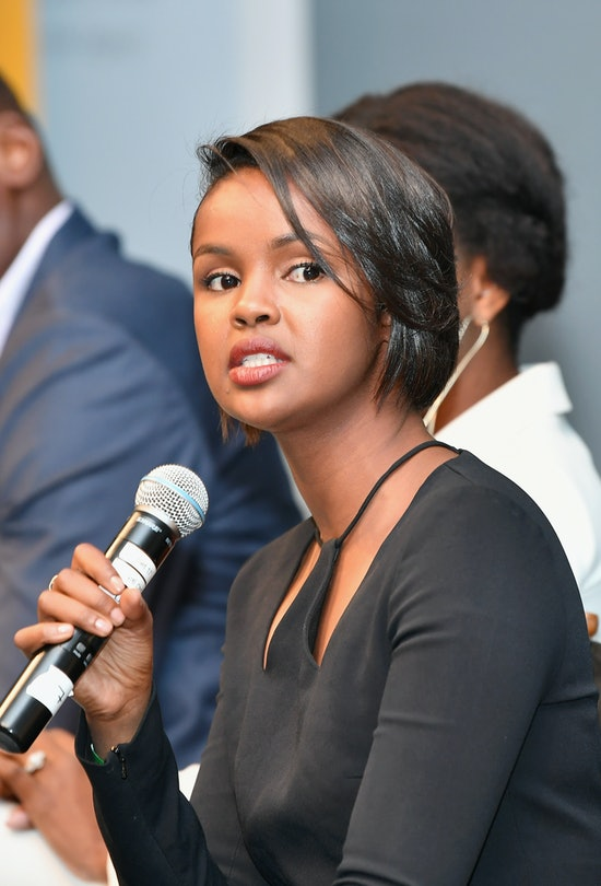 Canadian-Somalian social activist Ilwad Elman holds a microphone while speaking on a panel.