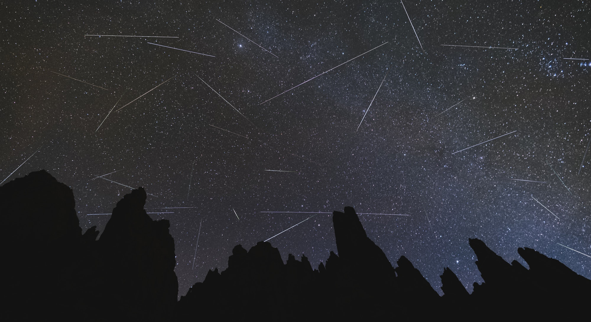 time lapse photo of stars and meteors
