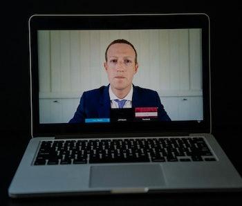 Facebook CEO Mark Zuckerberg is seen on a laptop screen.