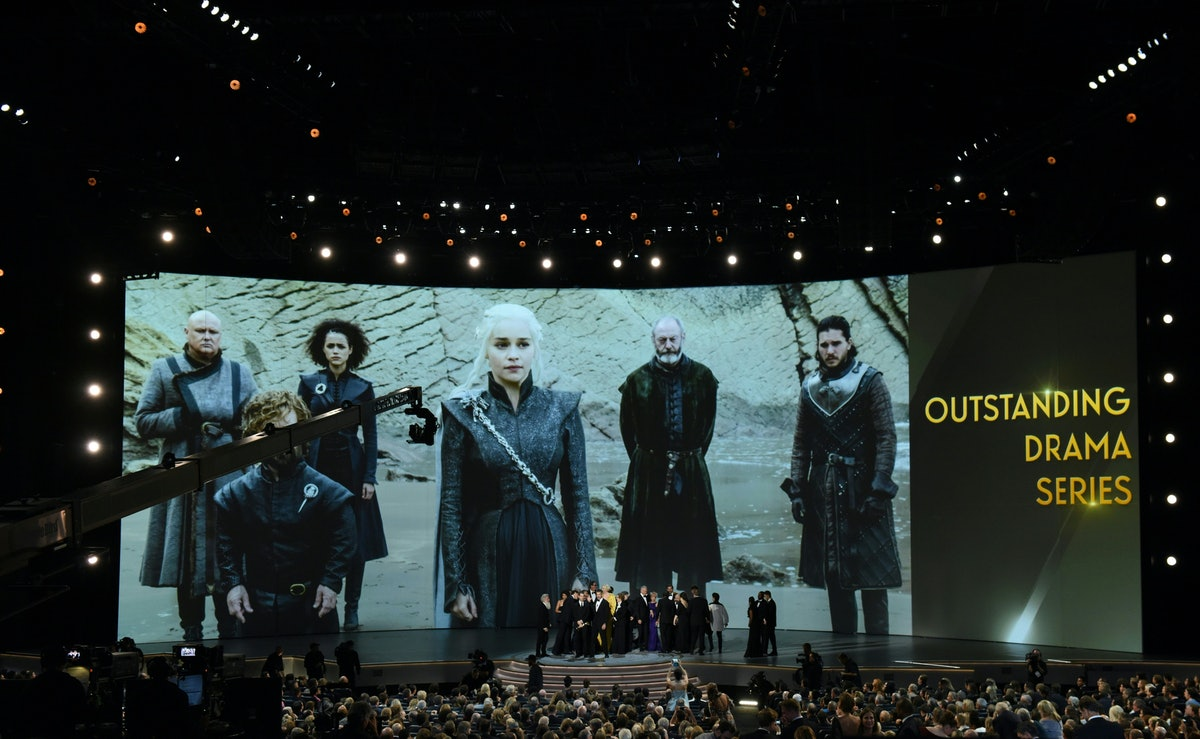 """The cast of """"Game of Thrones"""" celebrates the award Outstanding Drama series  onstage during the 70th Emmy Awards at the Microsoft Theatre in Los Angeles, California on September 17, 2018. (Photo by Robyn Beck / AFP)        (Photo credit should read ROBYN BECK/AFP via Getty Images)"""