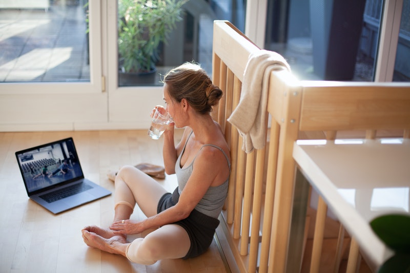 Woman practicing ballet at home due to COVID-19 lockdown