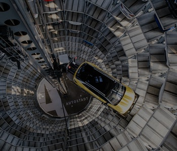 26 March 2021, Lower Saxony, Wolfsburg: A Volkswagen ID.4 stands in a car tower at Autostadt. Volksw...