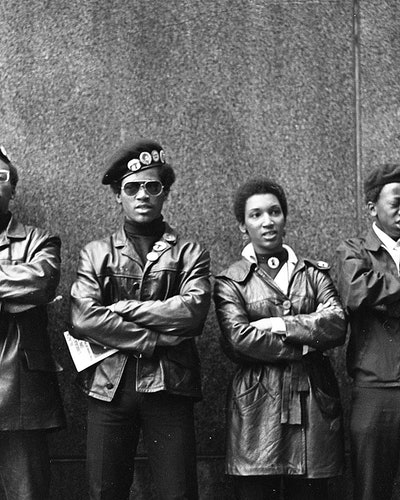 View of several Black Panther Party members as they demonstrate, arms folded, outside the New York County Criminal Court (at 100 Court Street), New York, New York, April 11, 1969. The demonstration was about the 'Panther 21' trial, over jailed Black Panther members accused of shooting at police stations and a bombing; all of whom were eventually acquitted. (Photo by David Fenton/Getty Images)
