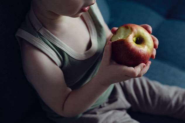 toddler with apple
