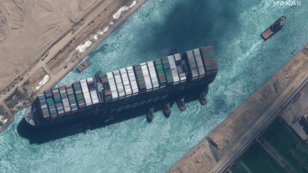STUCK SHIP EVER GIVEN, SUEZ CANAL -- MARCH 29, 2021:  Maxar new high-resolution satellite imagery of the Suez canal and the container ship (EVER GIVEN) and tugboats that have the ship nearly unstuck north of the city of Suez, Egypt.  Please use: Satellite image (c) 2020 Maxar Technologies.