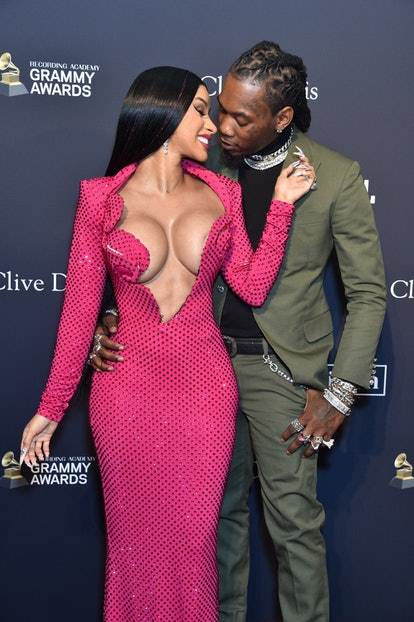 BEVERLY HILLS, CALIFORNIA - JANUARY 25: (EDITOR'S NOTE: Image contains partial nudity) (L-R) Cardi B...