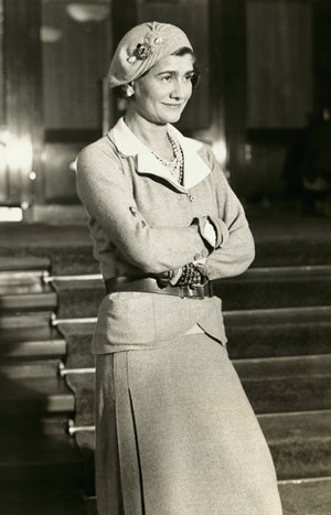"""Gabrielle """"Coco"""" Chanel in suit and beret. (Photo by George Rinhart/Corbis via Getty Images)"""