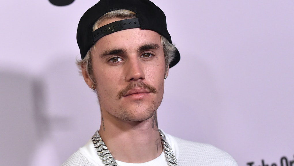 """Canadian singer Justin Bieber arrives for YouTube Originals' """"Justin Bieber: Seasons"""" premiere at the Regency Bruin Theatre in Los Angeles on January 27, 2020. (Photo by LISA O'CONNOR / AFP) (Photo by LISA O'CONNOR/AFP via Getty Images)"""