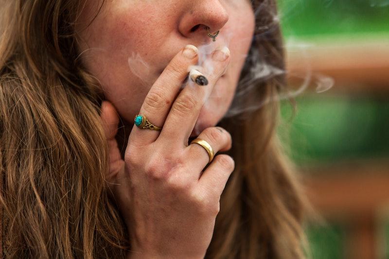 woman smoking marijuana