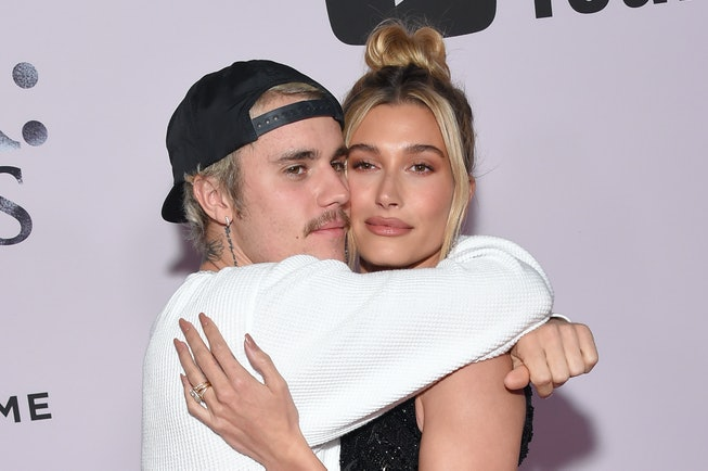 """Canadian singer Justin Bieber (L) and wife US model Hailey Bieber arrive for YouTube Originals' """"Justin Bieber: Seasons"""" premiere at the Regency Bruin Theatre in Los Angeles on January 27, 2020. (Photo by Lisa O'CONNOR / AFP) (Photo by LISA O'CONNOR/AFP via Getty Images)"""