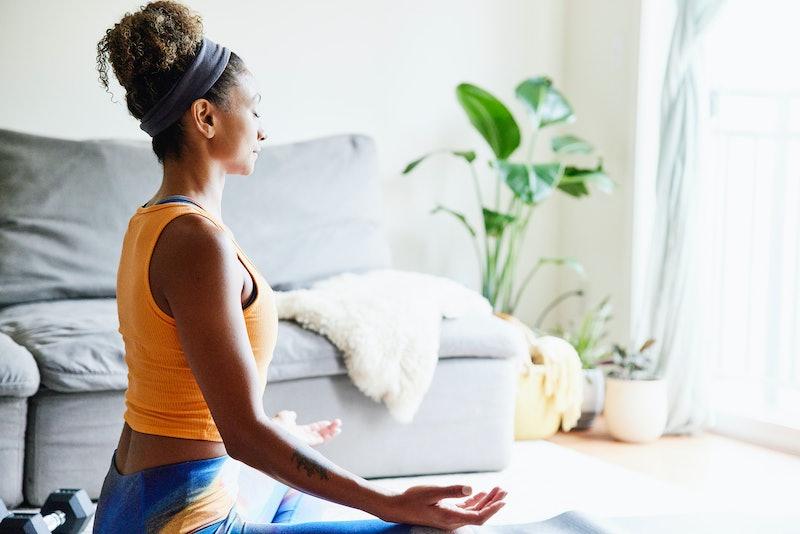woman meditating indoors