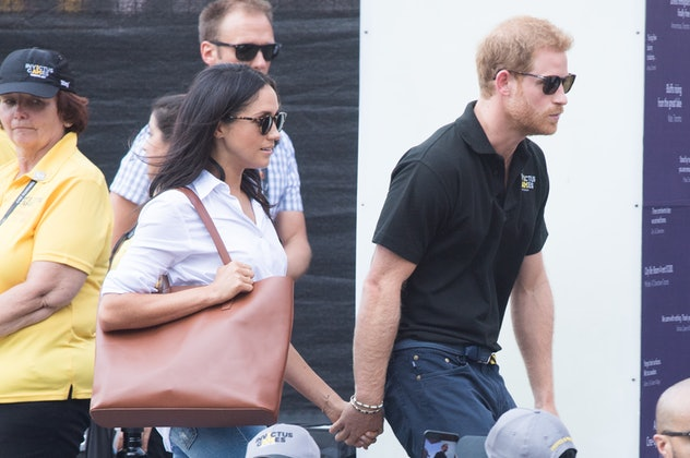 Meghan Markle and Prince Harry holding hands in 2017.