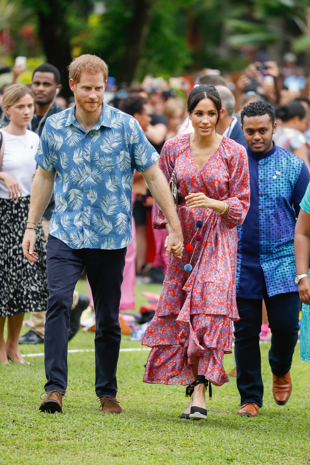 Prince Harry and Meghan Markle holding hands in Fiji, 2018.