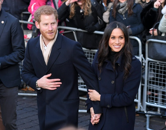 Prince Harry and Meghan Markle holding hands 2017.