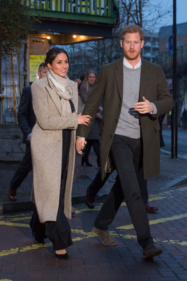 Meghan Markle holds Prince Harry's hand in 2018.