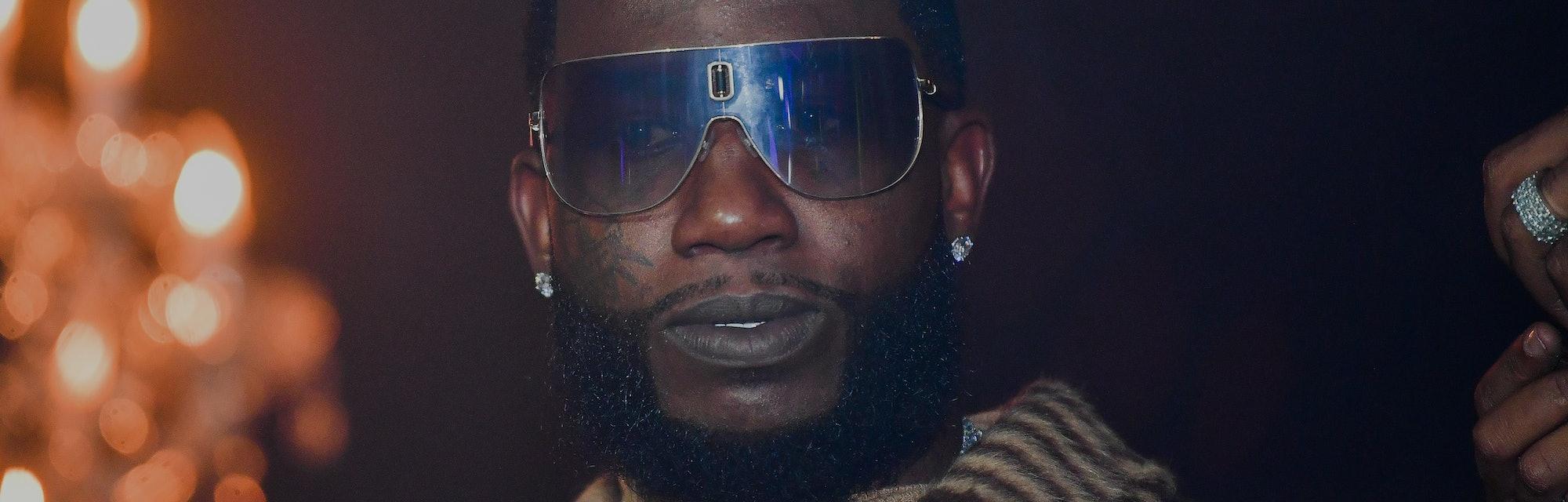 Trap legend Gucci Mane is seen wearing sunglasses.