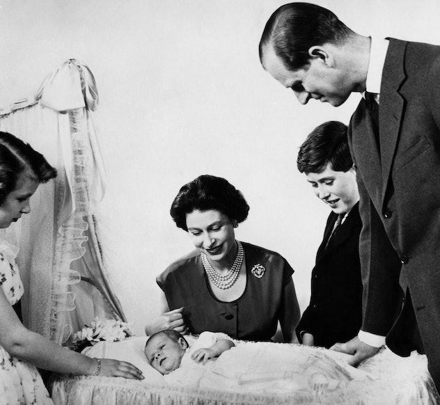 Prince Philip admires his new son, 1960.