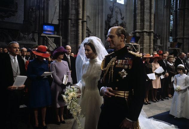 Prince Philip walks Princess Anne down the aisle in 1973.