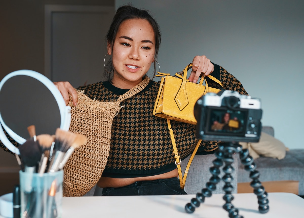 A woman films a haul video. What's the difference between Twitter Super Follows & OnlyFans? Here's how different creator monetization platforms work.