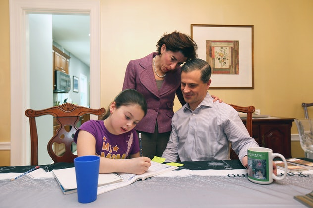 Gina Raimondo and her husband, Andrew Moffit, help their daughter Cecilia Moffitt with her homework.
