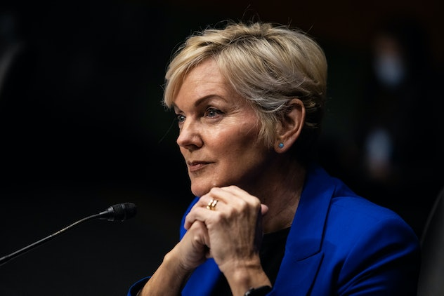 Jennifer Granholm sits behind a microphone in a blue blazer at her Senate confirmation hearing.