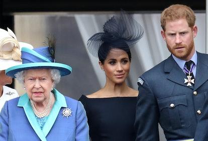 Meghan Markle, Queen Elizabeth, Prince Harry Photo via Getty