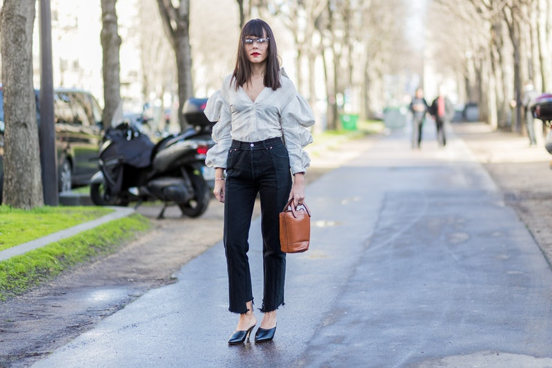 PARIS, FRANCE - MARCH 02: Evangeline Smyrotaki wearing a white top, black denim jeans, brown bag, outside Chloe on March 2, 2017 in Paris, France. (Photo by Christian Vierig/Getty Images)