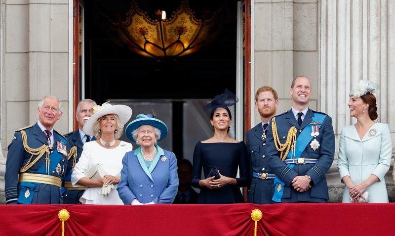 LONDON, UNITED KINGDOM - JULY 10: (EMBARGOED FOR PUBLICATION IN UK NEWSPAPERS UNTIL 24 HOURS AFTER CREATE DATE AND TIME) Prince Charles, Prince of Wales, Camilla, Duchess of Cornwall, Queen Elizabeth II, Meghan, Duchess of Sussex, Prince Harry, Duke of Sussex, Prince William, Duke of Cambridge and Catherine, Duchess of Cambridge watch a flypast to mark the centenary of the Royal Air Force from the balcony of Buckingham Palace on July 10, 2018 in London, England. The 100th birthday of the RAF, which was founded on on 1 April 1918, was marked with a centenary parade with the presentation of a new Queen's Colour and flypast of 100 aircraft over Buckingham Palace. (Photo by Max Mumby/Indigo/Getty Images)