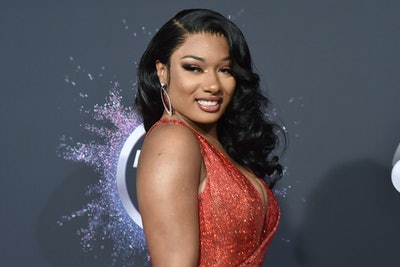 megan thee stallion wearing red sparkly dress