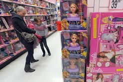 A woman and a little girl look at dolls on November 30, 2011, in a giant toys store in Strasbourg, e...