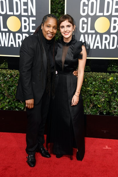 BEVERLY HILLS, CA - JANUARY 07:  Imkaan Executive Director Marai Larasi (L) and actor Emma Watson attend The 75th Annual Golden Globe Awards at The Beverly Hilton Hotel on January 7, 2018 in Beverly Hills, California.  (Photo by Frazer Harrison/Getty Images)