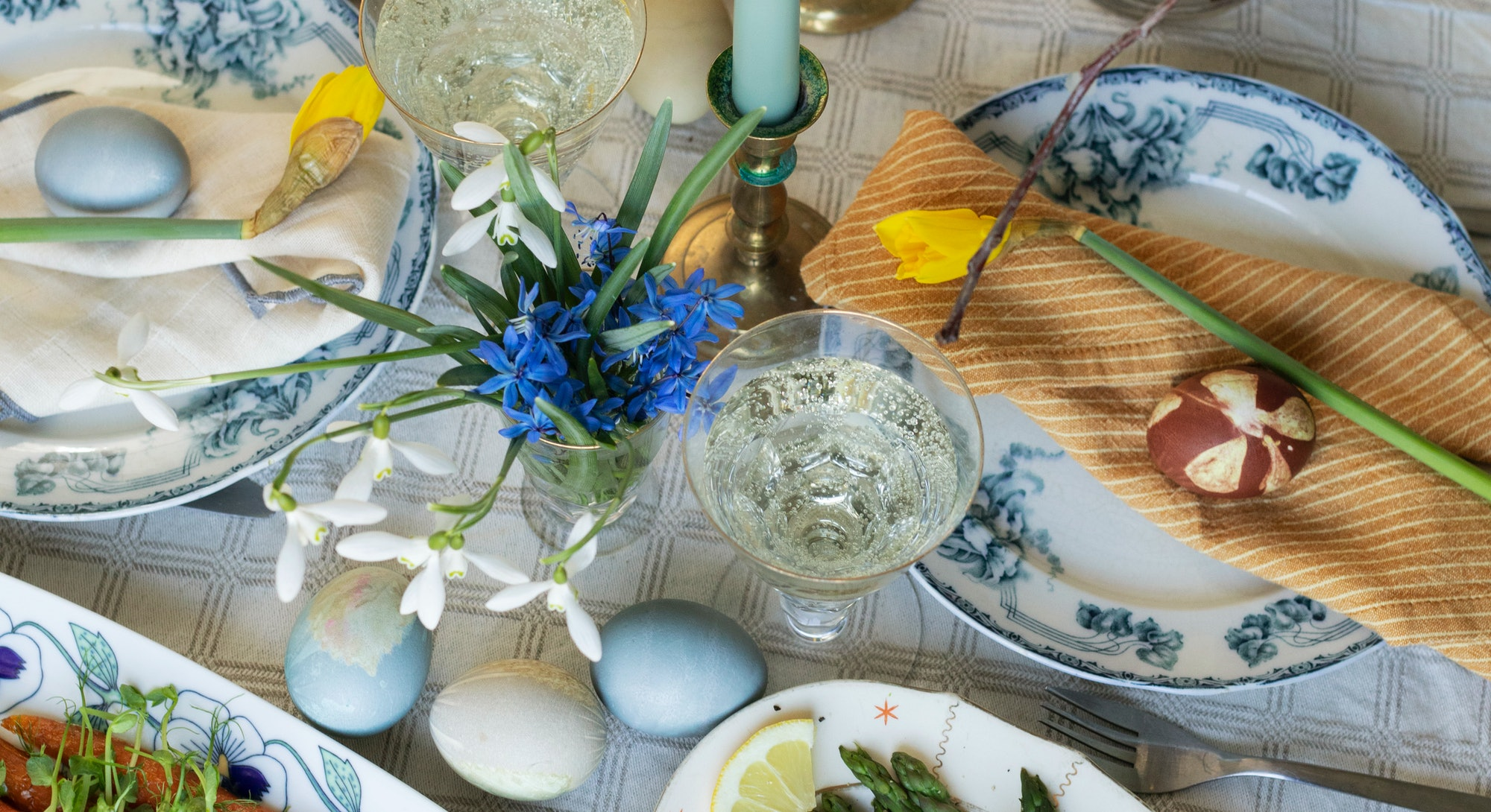 Easter brunch table shot from above, food, spring flowers and and eggs, Sweden