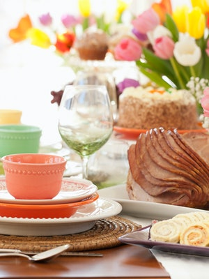 Easter ham brunch. Dining Table with a Centerpiece of Fresh Colorful Tulips