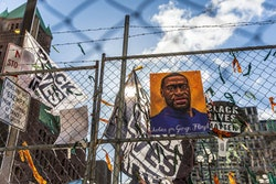 "A poster with George Floyd's picture and a sign reads that ""I Can't Breathe"" hang from a security fence outside the Hennepin County Government Center on March 31, 2021 in Minneapolis, Minnesota. - Derek Chauvin, 45, is charged with murder and manslaughter for his role in George Floyd's May 25, 2020 death, which was captured on video and seen by millions, sparking anti-racism protests around the globe.In the video, Chauvin, who was subsequently fired from the police department, is seen kneeling on the neck of a handcuffed Floyd for more than nine minutes. Floyd, who was being arrested for allegedly passing a counterfeit $20 bill in a nearby store, complains he cannot breathe and eventually falls unconscious. Other witnesses included an off-duty firefighter who said her attempts to render assistance to Floyd were rebuffed by police and a man who made an emergency 911 call after the incident to report a ""murder."" (Photo by Kerem Yucel / AFP) (Photo by KEREM YUCEL/AFP via Getty Images)"
