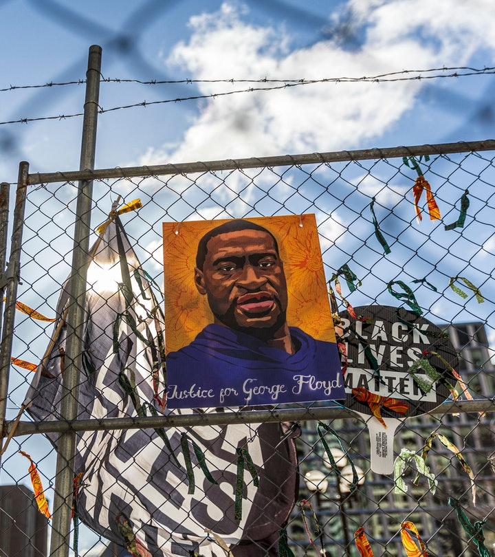 """A poster with George Floyd's picture and a sign reads that """"I Can't Breathe"""" hang from a security fe..."""