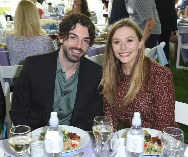 BEVERLY HILLS, CA - OCTOBER 08:  Robbie Arnett and Elizabeth Olsen attend The Rape Foundation's Annual Brunch on October 8, 2017 in Beverly Hills, California  (Photo by Vivien Killilea/Getty Images for The Rape Foundation)