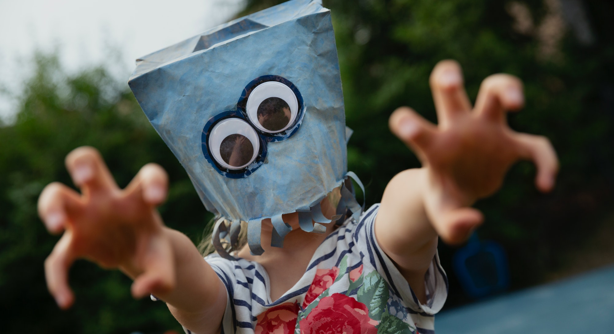 Add googly eyes to a paper bag for a monster mask.