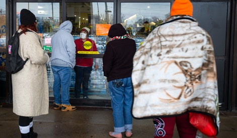 AUSTIN, TX - FEBRUARY 17, 2021: A Fiesta Mart staff member tells customers that the store is closed because of a power outage in Austin, Texas on February 17, 2021. Millions of Texans are still without water and electric as winter storms continue. (Photo by Montinique Monroe/Getty Images)