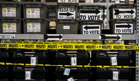 ATLANTA, GEORGIA - On the day after election day in Georgia shelves and shelves of sequestered voting machines, wrapped with yellow caution tape, still sit unrecorded, and unused, at the Fulton County Election Preparation Center in Atlanta, Georgia on Tuesday November 6, 2018. 700 voting machines in Fulton County remain sequestered due to a pending paper ballot lawsuit. Yesterday's record voter turnout had issues with  long lines for voters because of a lack of adequate numbers of polling machines in Fulton County. (Photo by Melina Mara/The Washington Post via Getty Images)