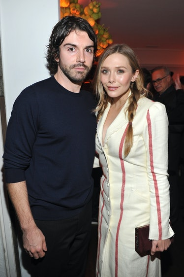 LOS ANGELES, CA - JANUARY 04:  Robbie Arnett (L) and Elizabeth Olsen attend W Magazine's Celebration...