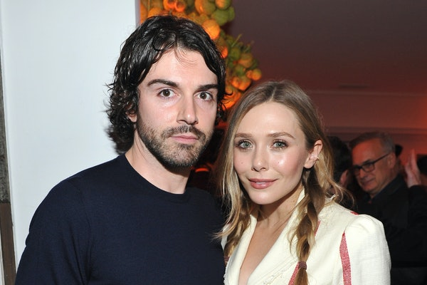 LOS ANGELES, CA - JANUARY 04:  Robbie Arnett (L) and Elizabeth Olsen attend W Magazine's Celebration of its 'Best Performances' Portfolio and the Golden Globes with Audi, Dior, and Dom Perignon at Chateau Marmont on January 4, 2018 in Los Angeles, California.  (Photo by Donato Sardella/Getty Images for W Magazine)