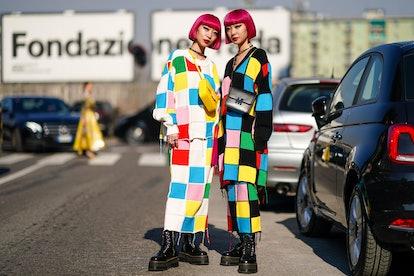 "MILAN, ITALY - FEBRUARY 22: Fashion twins Ami Zuzuki and Aya Suzuki ""AmiAya"" wear earrings, a neckla..."