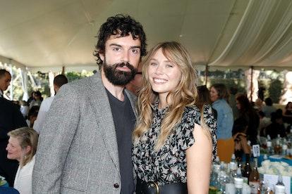 BEVERLY HILLS, CALIFORNIA - OCTOBER 06: (L-R) Robbie Arnett and Elizabeth Olsen attend the Rape Foun...