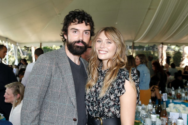 BEVERLY HILLS, CALIFORNIA - OCTOBER 06: (L-R) Robbie Arnett and Elizabeth Olsen attend the Rape Foundation Annual Brunch 2019 at a Beverly Hills Private Estate on October 06, 2019 in Beverly Hills, California. (Photo by Tibrina Hobson/Getty Images for The Rape Foundation)
