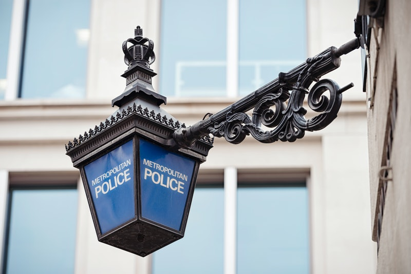 Close-up of a traditional police lantern, on display outside a police station in central London, England.