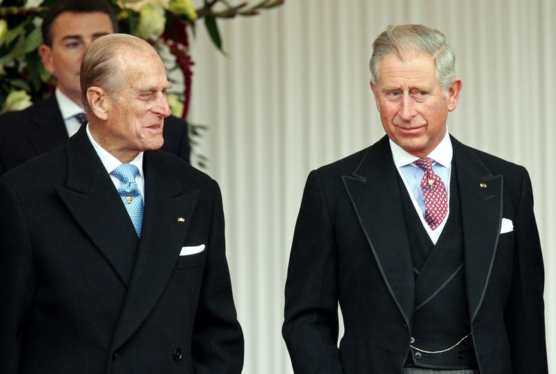 Britain's Prince Philip (L), stands wit his son Prince Charles (R), during a Ceremonial Welcome for Qatar's emir, Sheikh Hamad bin Khalifa al-Thani, and his wife Sheikha Mozah, in Windsor, west of London, on October 26, 2010.   The Emir and his wife will stay as a quest of Britain's Queen Elizabeth II during their four day State Visit.         AFP PHOTO / STEVE PARSONS / POOL (Photo by Steve Parsons / POOL / AFP) (Photo by STEVE PARSONS/POOL/AFP via Getty Images)